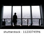 silhouette of a woman looking... | Shutterstock . vector #1123374596