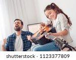 bearded man and little girl at... | Shutterstock . vector #1123377809