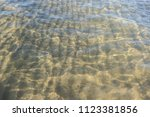 sandy seabed through... | Shutterstock . vector #1123381856