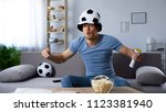 football supporter in fan hat... | Shutterstock . vector #1123381940