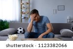 disappointed man shocked by... | Shutterstock . vector #1123382066