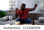 afro american man satisfied... | Shutterstock . vector #1123385696