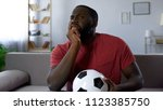 excited football fan watching... | Shutterstock . vector #1123385750