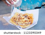 roti fried pouring with...   Shutterstock . vector #1123390349