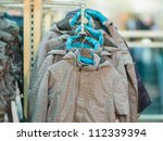 Winter jackets and vests in kids mall - stock photo