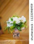 plastic flower in glass on... | Shutterstock . vector #1123398959