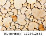 background of wooden hearts ...   Shutterstock . vector #1123412666