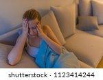 sick woman with a headache... | Shutterstock . vector #1123414244