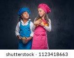 cute cook couple. little boy...   Shutterstock . vector #1123418663