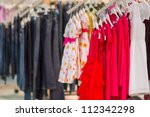 Dresses and jeans in kids mall - stock photo