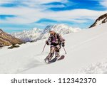 Woman Skier Descends The Steep...