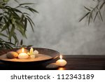 burning candles with zen stone... | Shutterstock . vector #112343189