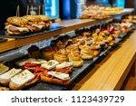 spanish tapas called pintxos of ... | Shutterstock . vector #1123439729