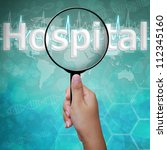 Hospital , word in Magnifying glass , background medical - stock photo