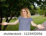 blonde woman unexpecting meet... | Shutterstock . vector #1123452056