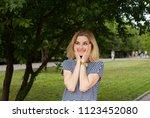 blonde woman unexpecting meet... | Shutterstock . vector #1123452080