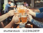 friends clinking glasses with... | Shutterstock . vector #1123462859