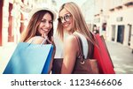 women in shopping. two happy... | Shutterstock . vector #1123466606