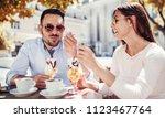 romantic couple drinking coffee ... | Shutterstock . vector #1123467764