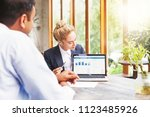 marketing team working on a... | Shutterstock . vector #1123485926