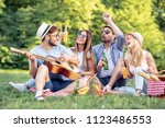 happy young friends having... | Shutterstock . vector #1123486553