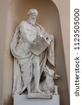 Small photo of Statue of Luke the Evangelist on the wall of Vilnius Cathedral, Lithuania