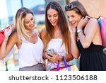 happy girl friends shopping in... | Shutterstock . vector #1123506188