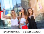happy girl friends shopping in... | Shutterstock . vector #1123506200
