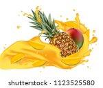 splash of ananas juice. mango... | Shutterstock . vector #1123525580