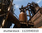 abandoned gas storage tank in... | Shutterstock . vector #1123540310
