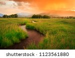colorful summer sunset in rural ... | Shutterstock . vector #1123561880