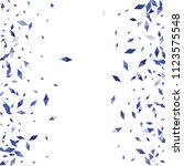 confetti of two colored rhombs... | Shutterstock .eps vector #1123575548