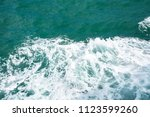 deep blue sea water surface... | Shutterstock . vector #1123599260