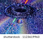 Closeup Of Water Drops On A Cd...