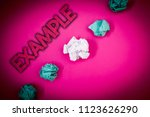 Small photo of Conceptual hand writing showing Example. Business photo text Illustration Sample Model to follow Guide Explanation For instance Ideas messages pink background crumpled papers several tries.