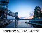 a mild twilight over a boat... | Shutterstock . vector #1123630790