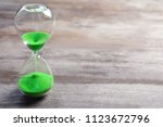 hourglass with flowing sand on... | Shutterstock . vector #1123672796