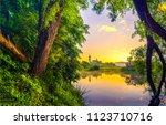 summer rural river sunset... | Shutterstock . vector #1123710716
