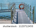 gangway  descent from the shore ... | Shutterstock . vector #1123712453