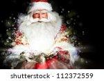 Santa Sitting At The Christmas...