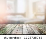 closeup top wood table with... | Shutterstock . vector #1123735766