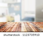 closeup top wood table with... | Shutterstock . vector #1123735910