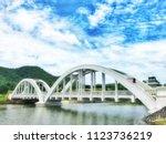 the white bridge  saphan khao ...   Shutterstock . vector #1123736219