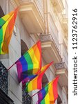 gay flags waving on balconies... | Shutterstock . vector #1123762916