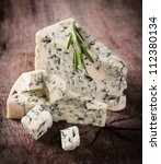 blue cheese on wooden background