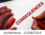 Small photo of Conceptual hand writing showing Consequences. Business photo showcasing Result Outcome Output Upshot Difficulty Ramification Conclusion Man hold holding marker paper thoughts messages intentions.