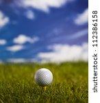 golf ball on green grass over a ... | Shutterstock . vector #112386158