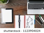 laptop  tablet and notebook are ... | Shutterstock . vector #1123904024