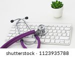 close up of stethoscope on pc... | Shutterstock . vector #1123935788