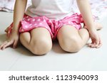 girl wearing pink skirt siting...   Shutterstock . vector #1123940093